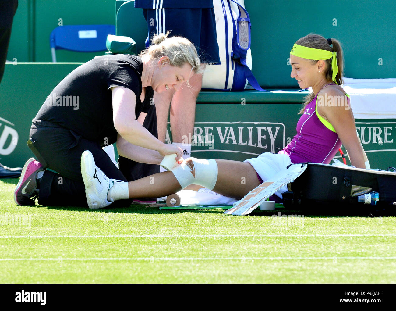 Aleksandra Krunic (Slovakia) receiving on court medical help and physiotherapy during the Nature Valley International, Eastbourne 26th June 2018 - Stock Image