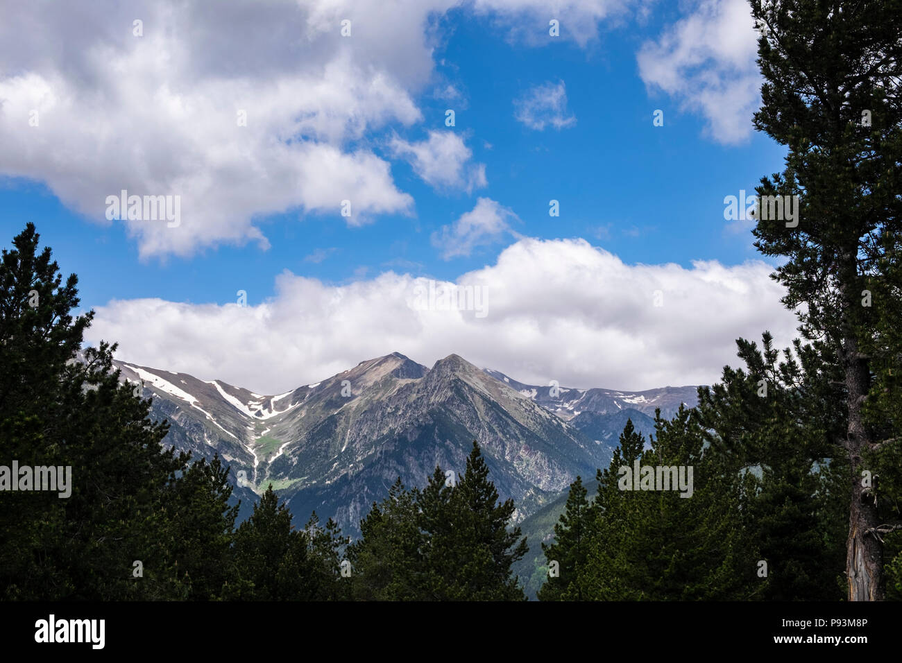 Mountain ridge with snow patches seen from the GR11 near Setcases in the Catalonian Pyrenees, Spain - Stock Image