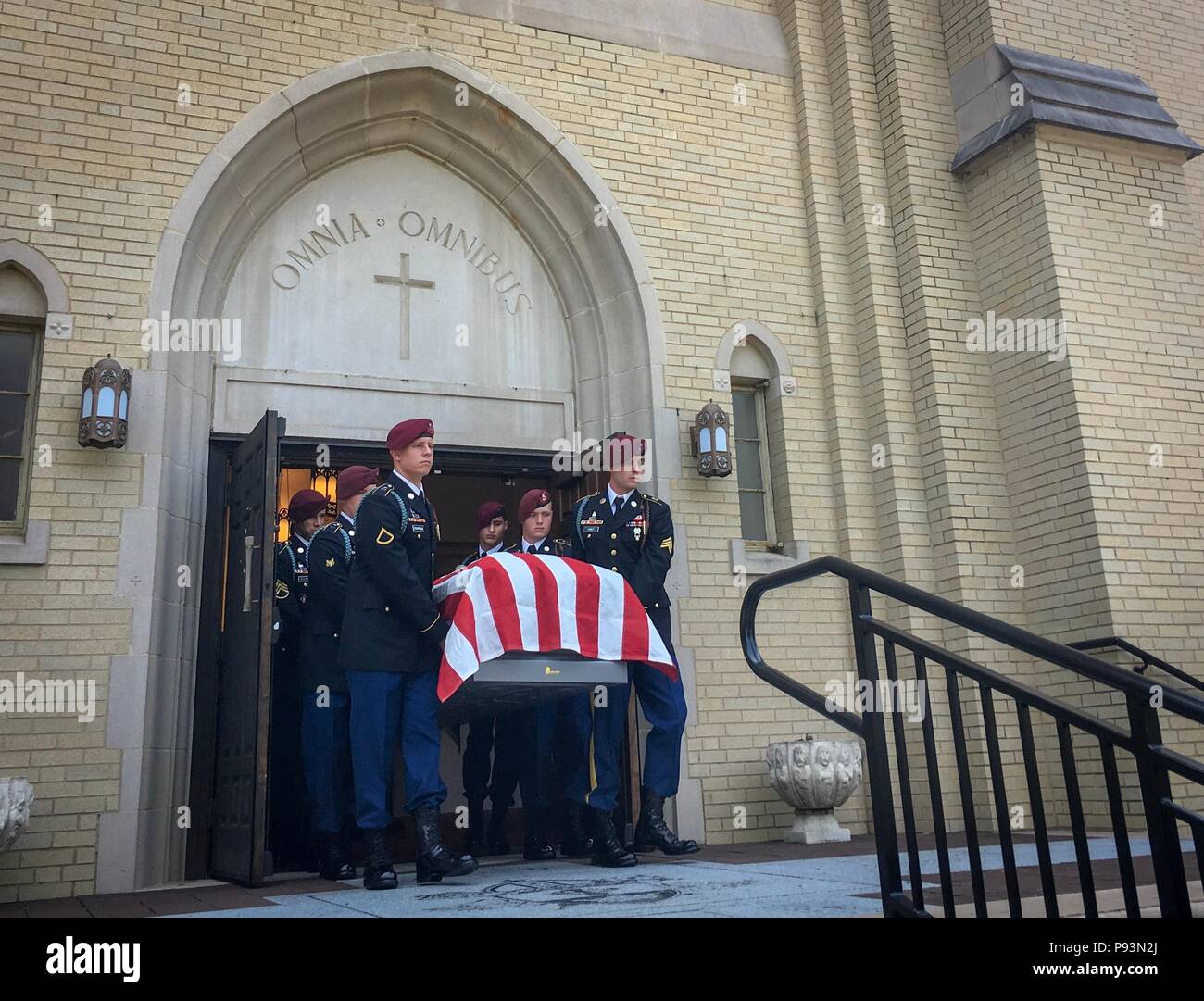 The casket of retired 1st Sgt  Harold Eatman is carried by