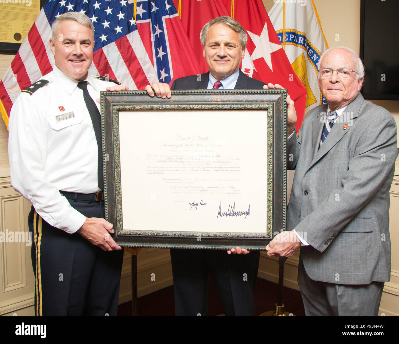 Mississippi River Commission President Maj. Gen. Richard Kaiser and MRC member Sam Angel present an appointment letter to James A. Reeder at the MRC headquarters in Vicksburg, Miss., July 11, 2018. President Donald Trump appointed Reeder as a member of the Mississippi River Commission May 17, 2018. Commission appointments are nominated by the President of the United States and vetted by the U.S. Senate. (USACE photo by Jared Eastman) - Stock Image