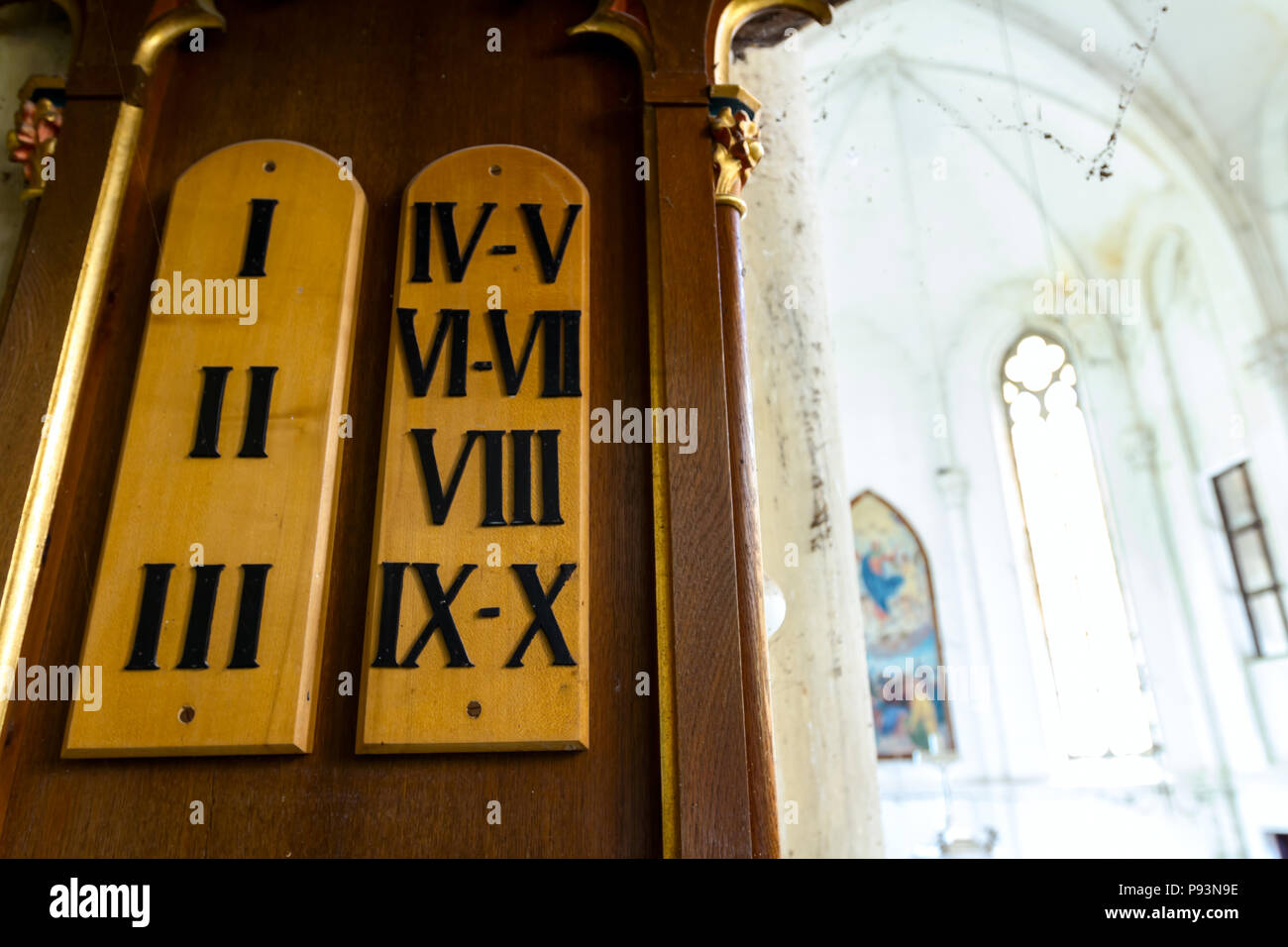 Ten Commandments are written on wooden board in Roman numbers. - Stock Image