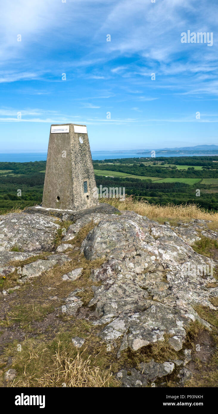 The trig point at the highest point on the island of Anglesey. Before GPS trig points were used by Ordinance Survey to accurately map Great Britain. - Stock Image