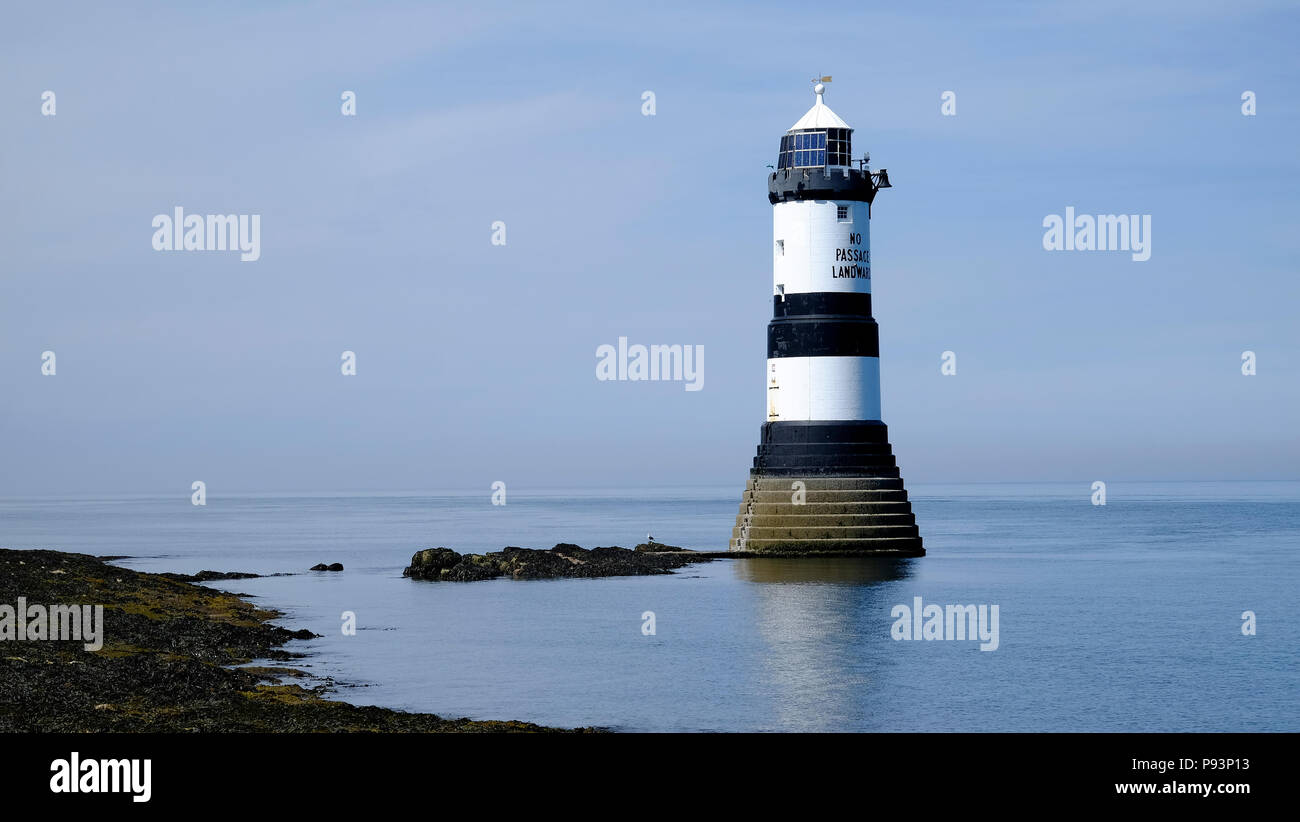 Grade II listed Trwyn Du Lighthouse on the Anglesey coast between Black Point near Penmon and Ynys Seriol (Puffin Island), North Wales, UK Stock Photo