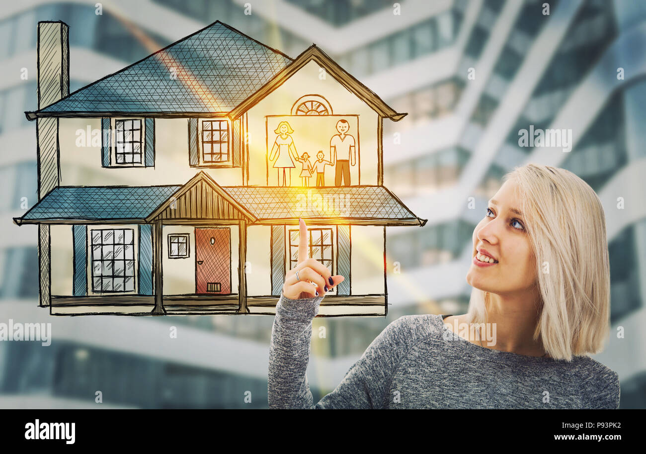 Portrait of smiling woman pointing finger up to a house and happy family hologram. Future technology for family insurance and home protection. - Stock Image