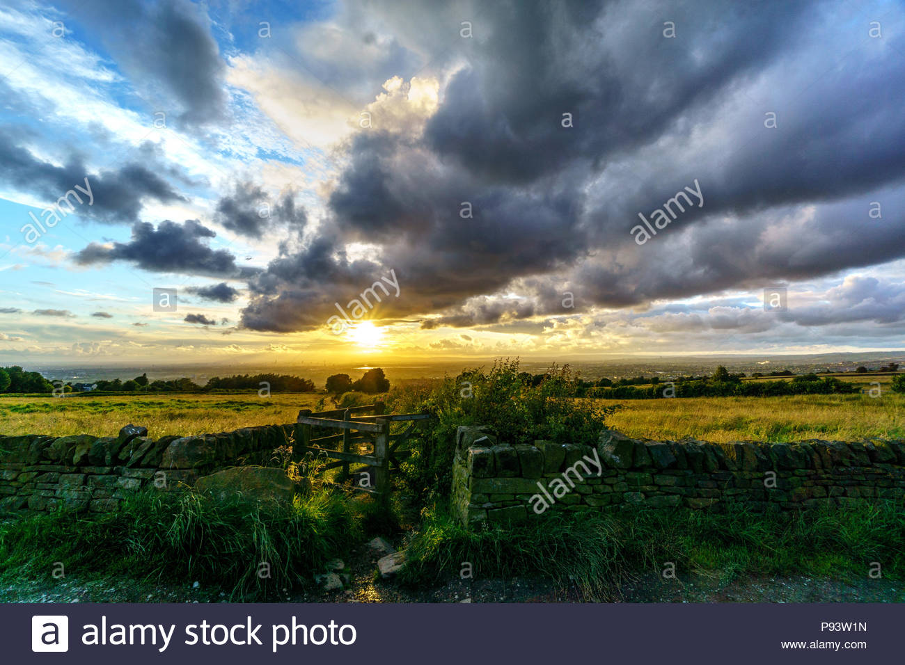 Sunset over Werneth Low with the city of Manchester in the distcance - Stock Image