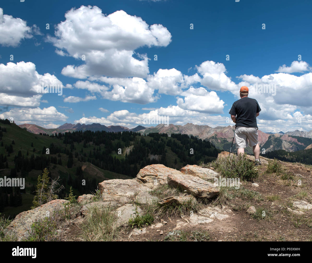 Alpine Hiker Taking in Natures Beauty High in the Rocky Mountains - Stock Image