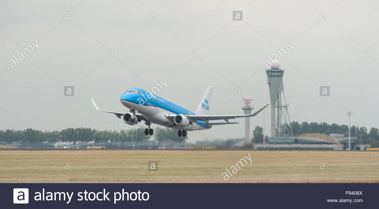 Amsterdam Schiphol Airport The Netherlands  KLM Cityhopper Embraer ERJ-175 PH-EXG  taking off from Schiphol Airport Polderbaan, Polder runway - Stock Image