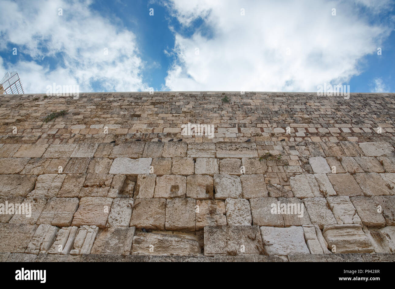 Western Wall ashlar stones during a summer cloudy morning. - Stock Image