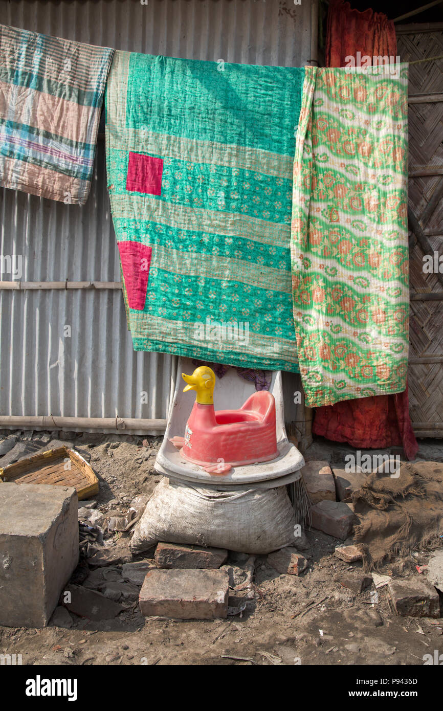 Baby potty in polluted Hazaribagh, leather factories / tanneries district, Dhaka, Bangladesh - Stock Image