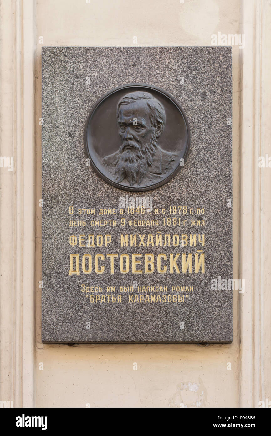 Commemorative plaque on the house where Russian novelist Fyodor Dostoyevsky lived and died in Kuznechny Lane in Saint Petersburg, Russia. Text in Russian means: Fyodor Dostoevsky lived in this house in 1846 and later from October 1878 until the day of his death on 9 February 1881. He wrote his novel The Brothers Karamazov here. The apartment of the novelist is now a part of the Dostoevsky Literary Memorial Museum. - Stock Image