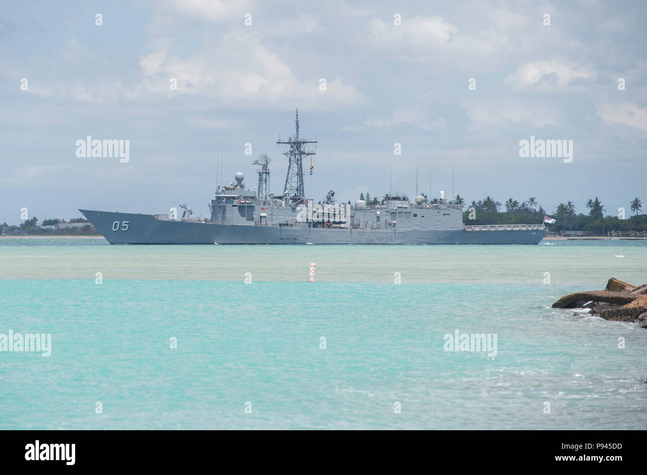 180709-N-IY142-001 PEARL HARBOR (July 9, 2018) -- Royal Australian Navy guided-missile frigate HMAS Melbourne (FFG 05) departs Joint Base Pearl Harbor-Hickam during Rim of the Pacific (RIMPAC) 2018. Twenty-five nations, 46 ships, five submarines, about 200 aircraft, and 25,000 personnel are participating in RIMPAC from June 27 to Aug. 2 in and around the Hawaiian Islands and Southern California. The world's largest international maritime exercise, RIMPAC provides a unique training opportunity while fostering and sustaining cooperative relationships among participants critical to ensuring the s - Stock Image
