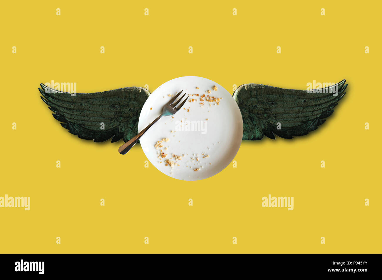 Minimal conceptual illustration of an empty plate with crumbs and wings on a colored background. - Stock Image