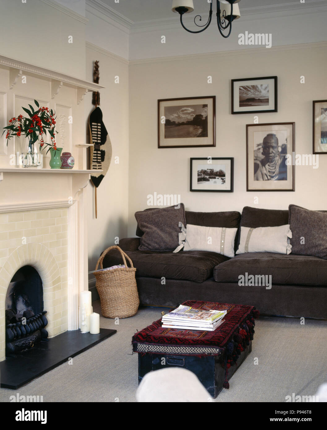 Pleasant Black White African Photographs Above Dark Grey Sofa In Pdpeps Interior Chair Design Pdpepsorg