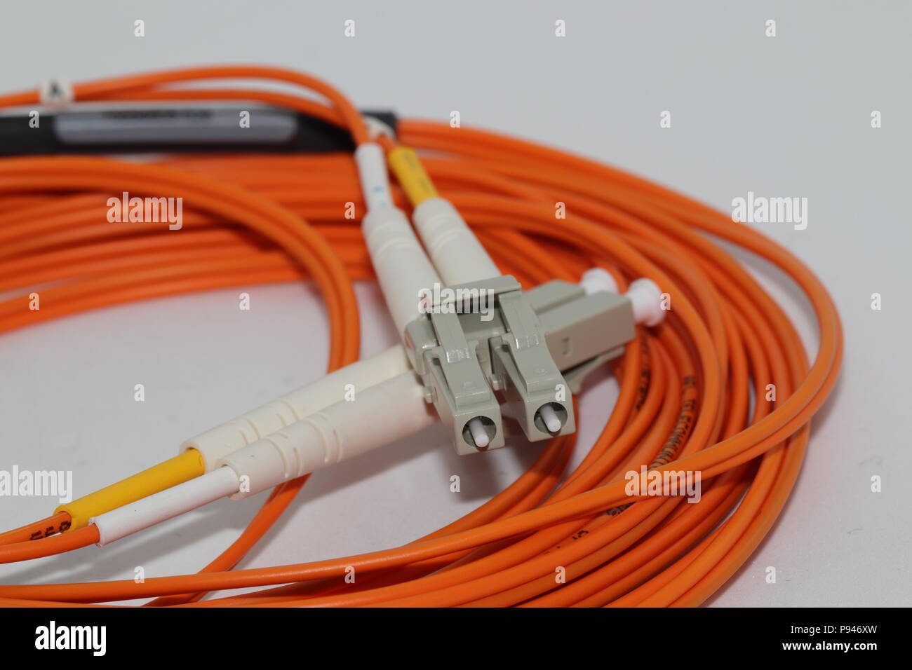 Fiber optics LC duplex connectors patch cord , isolated on white background - Stock Image
