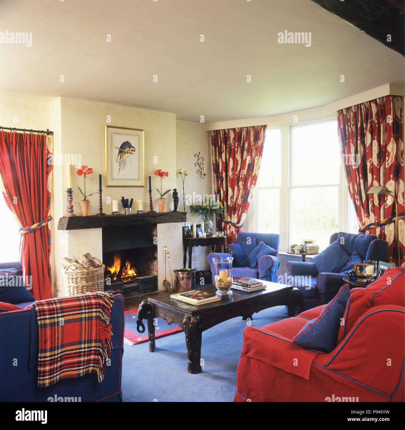 Red Sofa And Blue Armchairs In Traditional Living Room Stock Photo Alamy