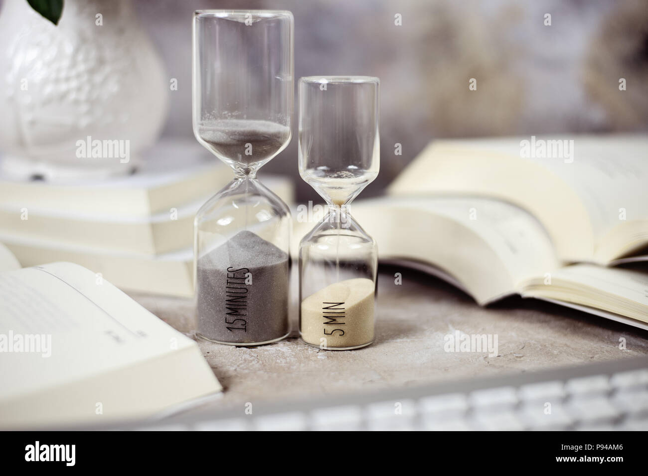 Time passing concept,urgency and running out of time. Sand fall in hourglass - Stock Image