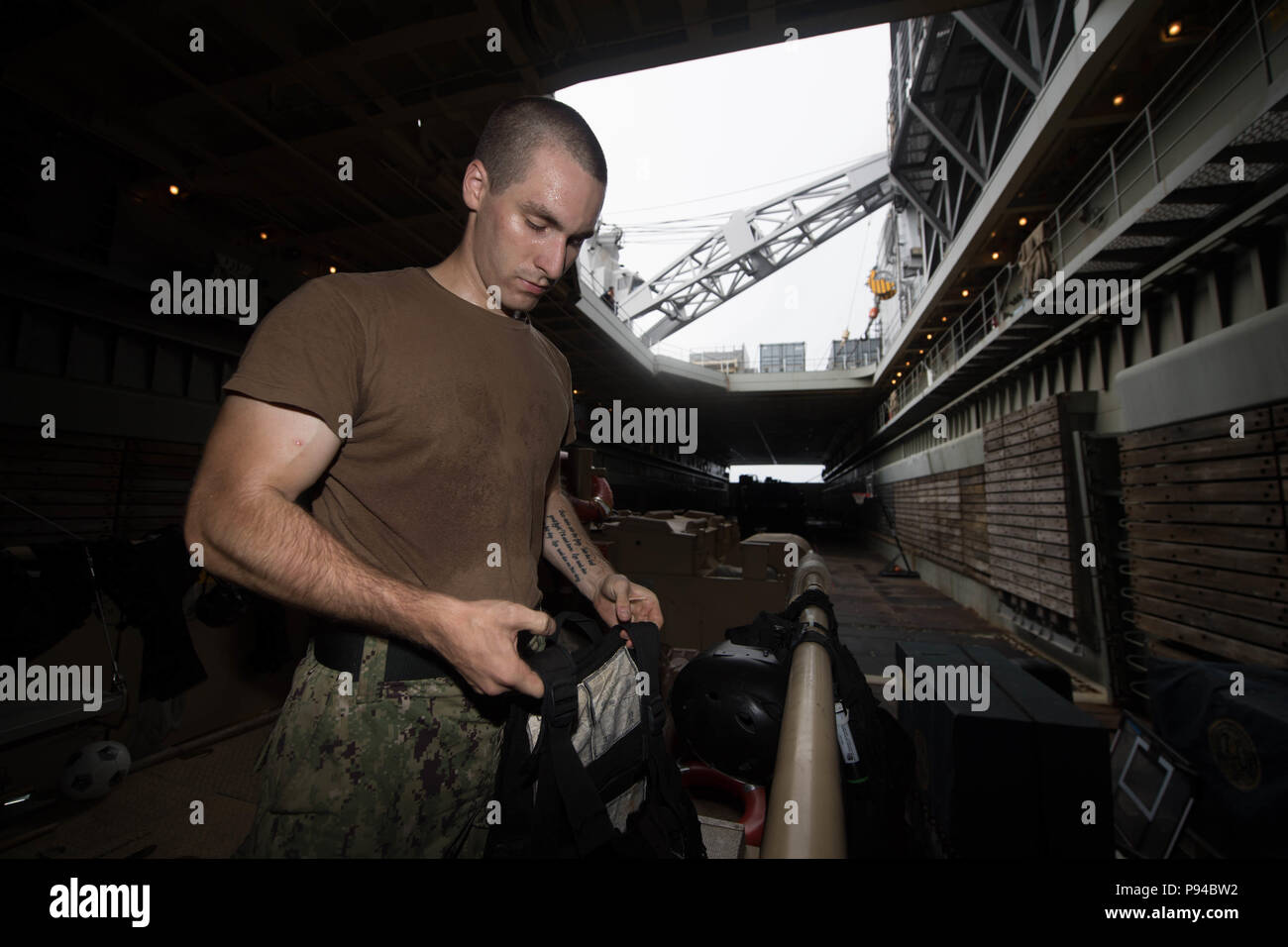 180709-N-GX781-0084 CARIBBEAN SEA (July 9, 2018) Gunner's Mate Seaman Andrew Badalich performs maintenance on tactical flotation devices aboard the Whidbey Island-Class Dock Landing Ship USS Gunston Hall (LSD 44). The ship is on deployment supporting Southern Seas, which is an annual collaborative deployment in the U.S. Southern Command area of responsibility where a task group will deploy to conduct a variety of exercises and multinational exchanges to enhance interoperability, increase regional stability, and build and maintain regional relationships with countries throughout the region thro Stock Photo