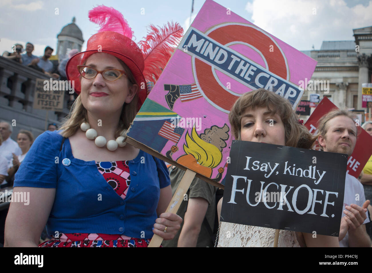 Women hold their handmade placards at the Carnival of Resistance, the anti-Trump protest organised in London, UK on the 13th July 2018. - Stock Image