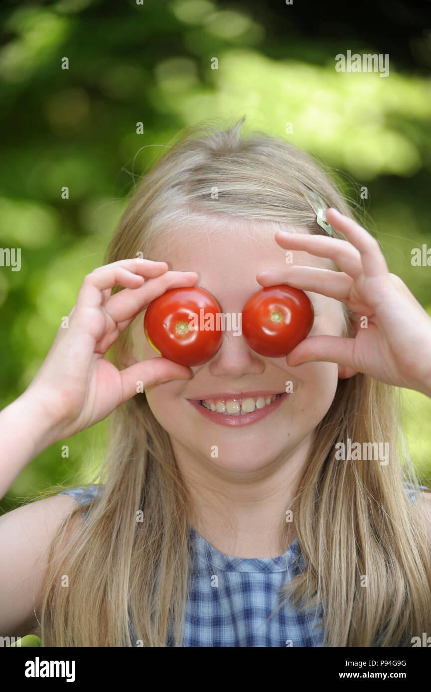 Tomaten auf den Augen - Stock Image