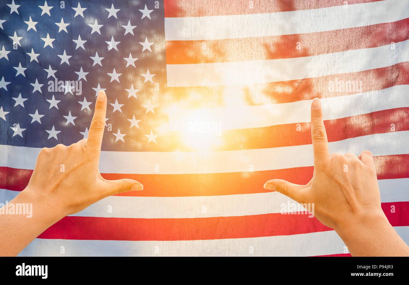 Hands Framing Sun Shining Through American Flag Stock Photo ...