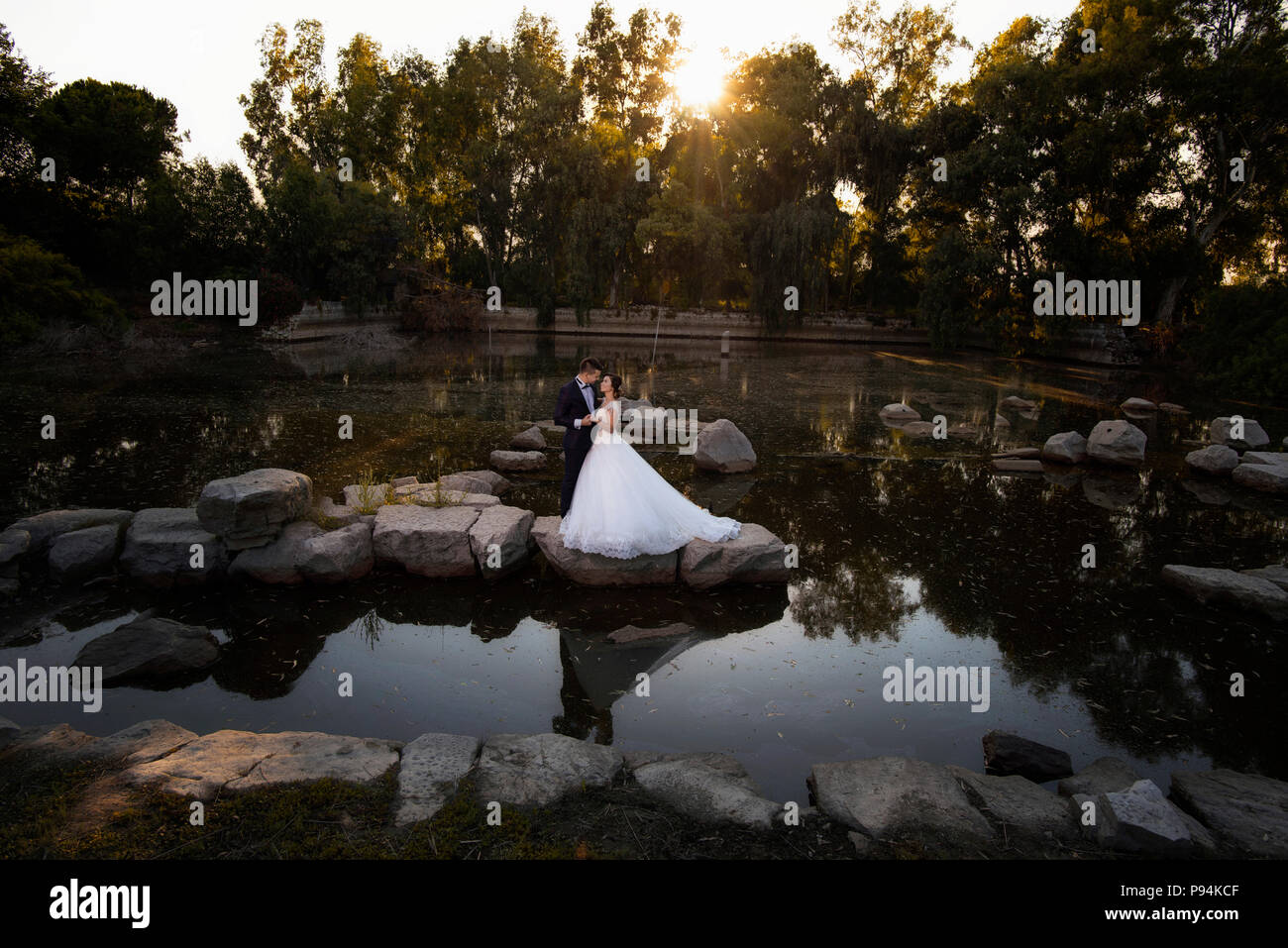 Bride and groom in Ancient city Ephesus ruins Celcus library wedding ceremony in ancient city ruins - Stock Image