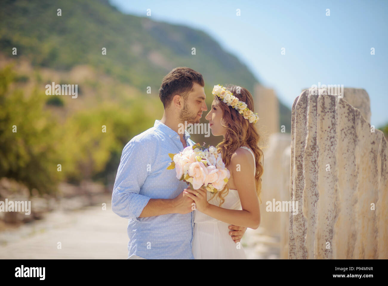 Wedding bride and groom, wedding in ancient city Ephesus among the ancient ruins, bridegroom love marriage marrying couple - Stock Image