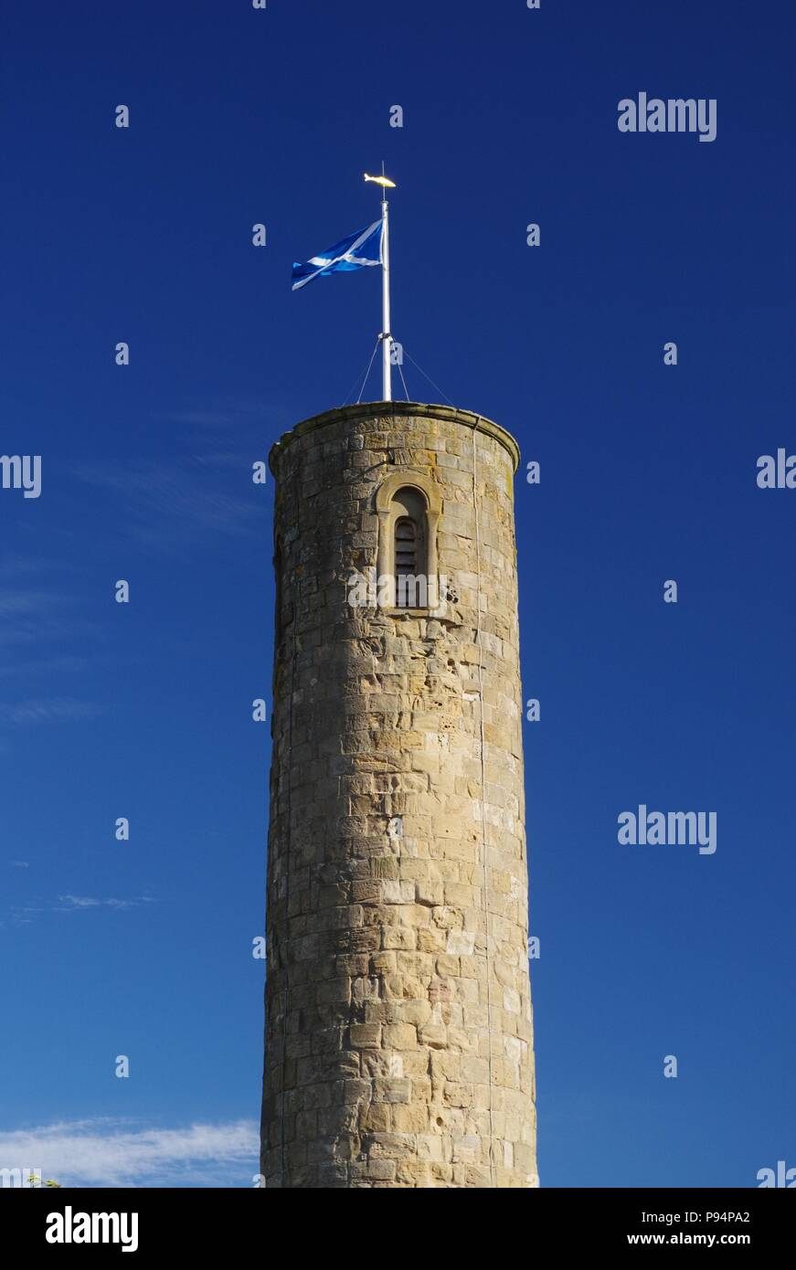 Abernethy 11th Century Round Tower St Andrews Saltire Flag against a Blue Summer Sky. Perth, Scotland, UK. July, 2018. - Stock Image