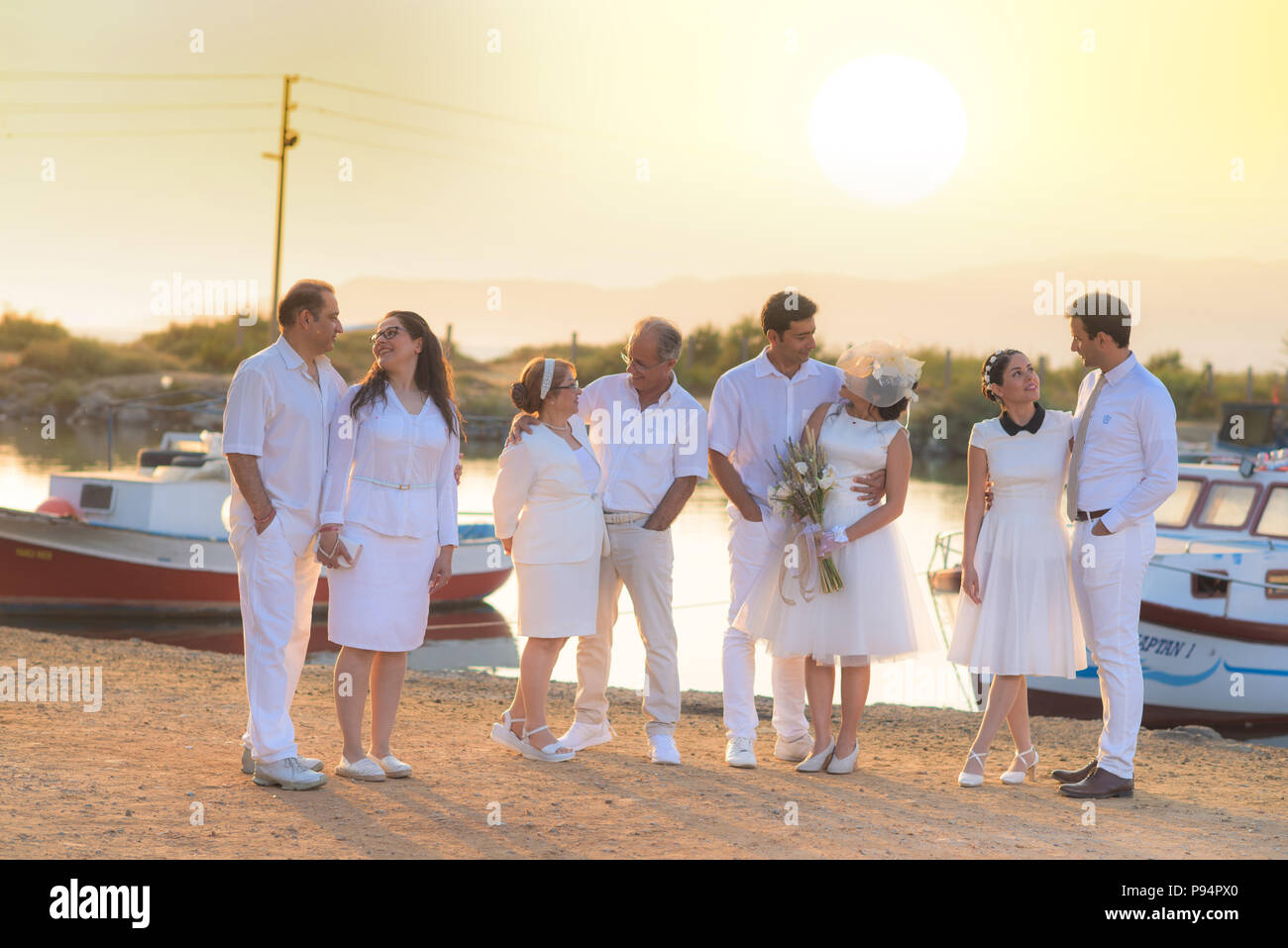 Wedding ceremony all family members attending wedding invitation, bride groom, father, father in law, mother in low, relatives - Stock Image