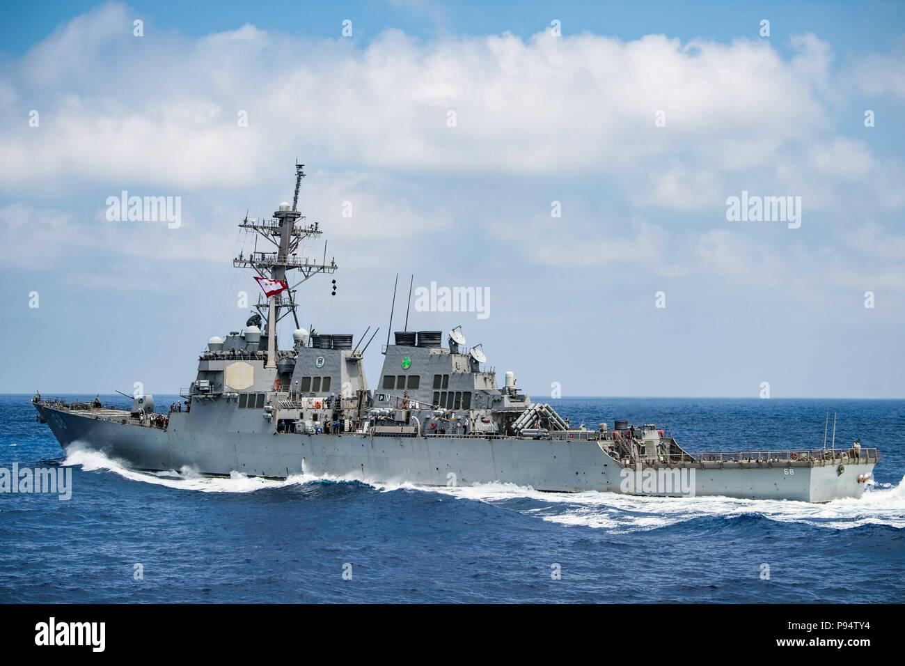180625-N-PY230-1256 MEDITERRANEAN SEA (June 25, 2018) The guided-missile destroyer USS The Sullivans (DDG 68) transits the Mediterranean Sea. The Sullivans is conducting naval operations in the U.S. 6th Fleet area of operations in support of U.S. national security interests in Europe. (U.S. Navy photo by Senior Chief Intelligence Specialist Matt Bodenner/Released) Stock Photo