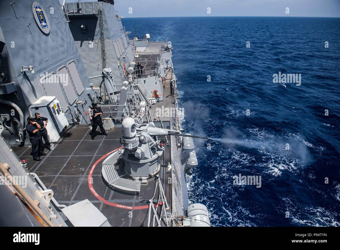 180627-N-UX013-0283 MEDITERRANEAN SEA (June 27, 2018) The guided-missile destroyer USS Jason Dunham (DDG 109) fires its MK-38 25mm machine gun during a pre-action calibration fire exercise. Dunham is operating in the U.S. 6th Fleet area of operations in support of U.S. national security interests in Europe. (U.S. Navy photo by Mass Communication Specialist 3rd Class Jonathan Clay/Released) Stock Photo