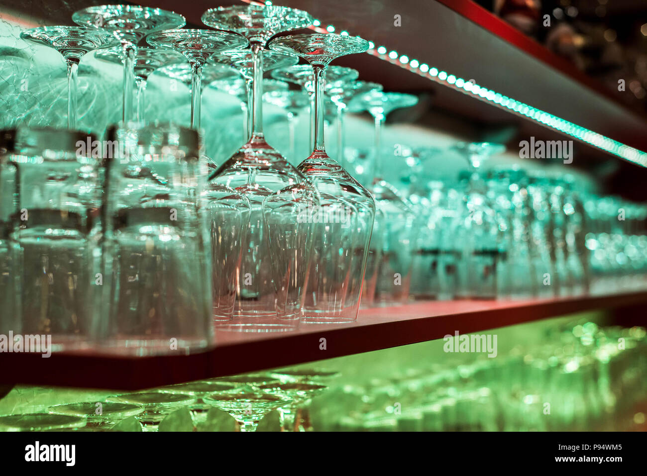Crystal glass, row and Stack of different glass shelf behind the bar ...