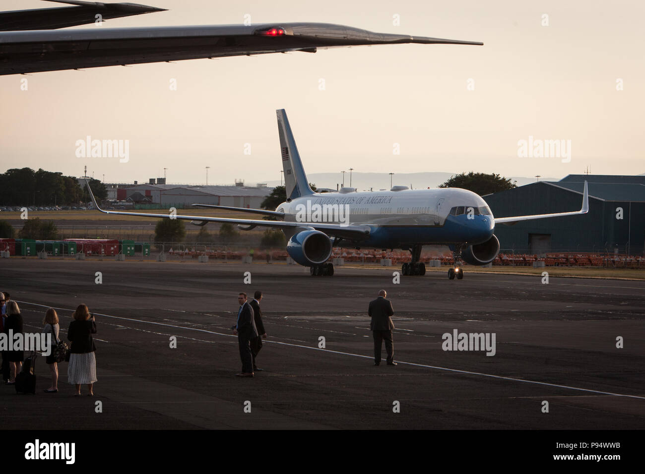 Prestwick, Scotland, on 13 July 2018. President Donald Trump, and wife Melania, arrive on Air Force One at Glasgow Prestwick International Airport at the start of a two day trip to Scotland. Image Credit: Jeremy Sutton-Hibbert/ Alamy News. Stock Photo