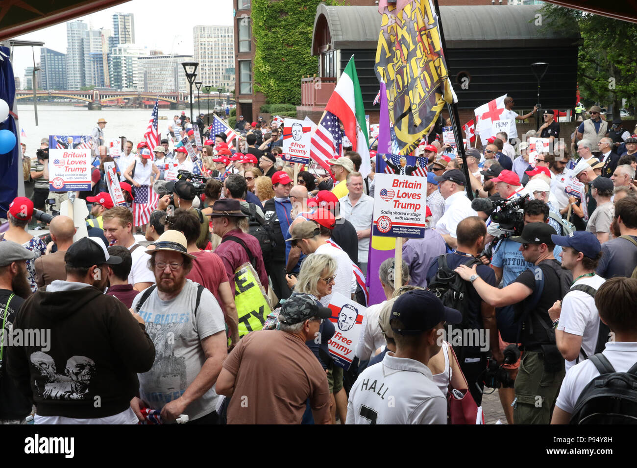 London, England. 14th July 2018. Despite police attempts to prevent the pro-Trump protest due to fears of violence from far-left counter protesters, supporters of Donald Trump assembled at midday outside the US Embassy in Vauxhall, London to welcome him on his visit to the UK. Credit: Richard Milnes/Alamy Live News Stock Photo