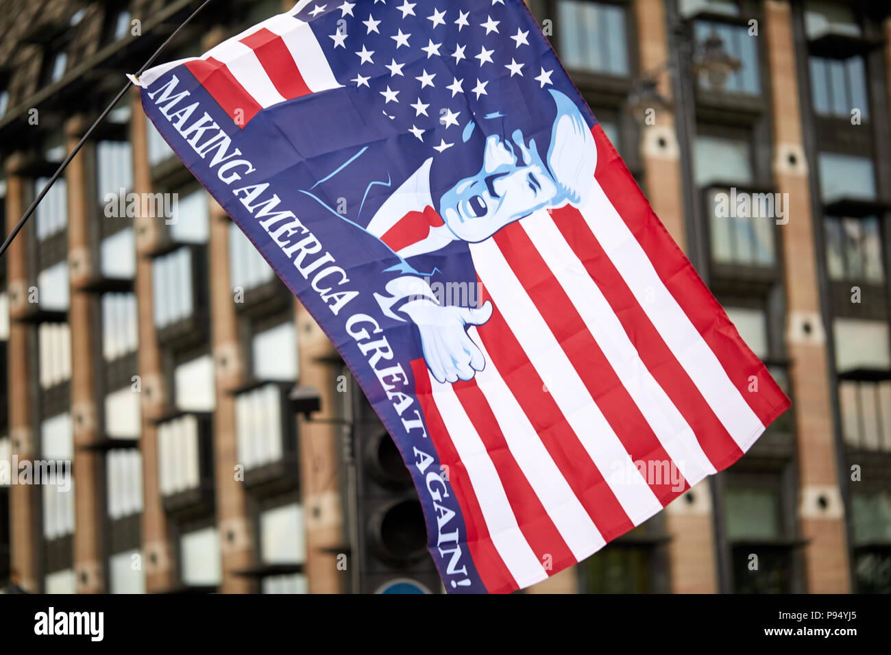 London, U.K. - 14 July 2018: A 'Making America Great Again' flies in front of Portcullis House, Westminster during a Pro-Donald Trump rally and march. Stock Photo