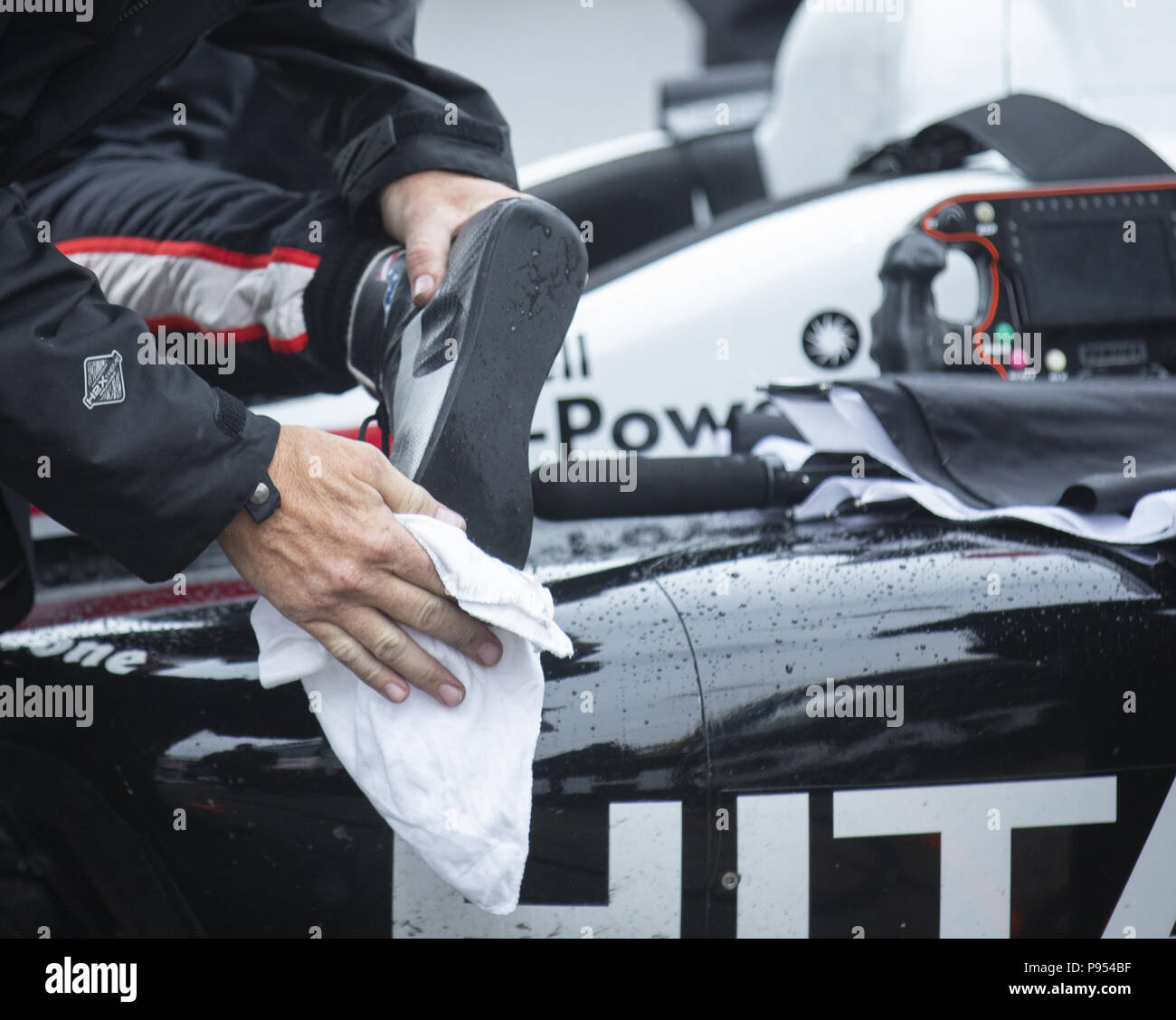 Toronto, Ontario, Canada. 14th July, 2018. A Team Penske Crew Member Wipes  The Soles Of The Shoes Of Driver Josef Newgarden Before He Got Into His Car  To ...