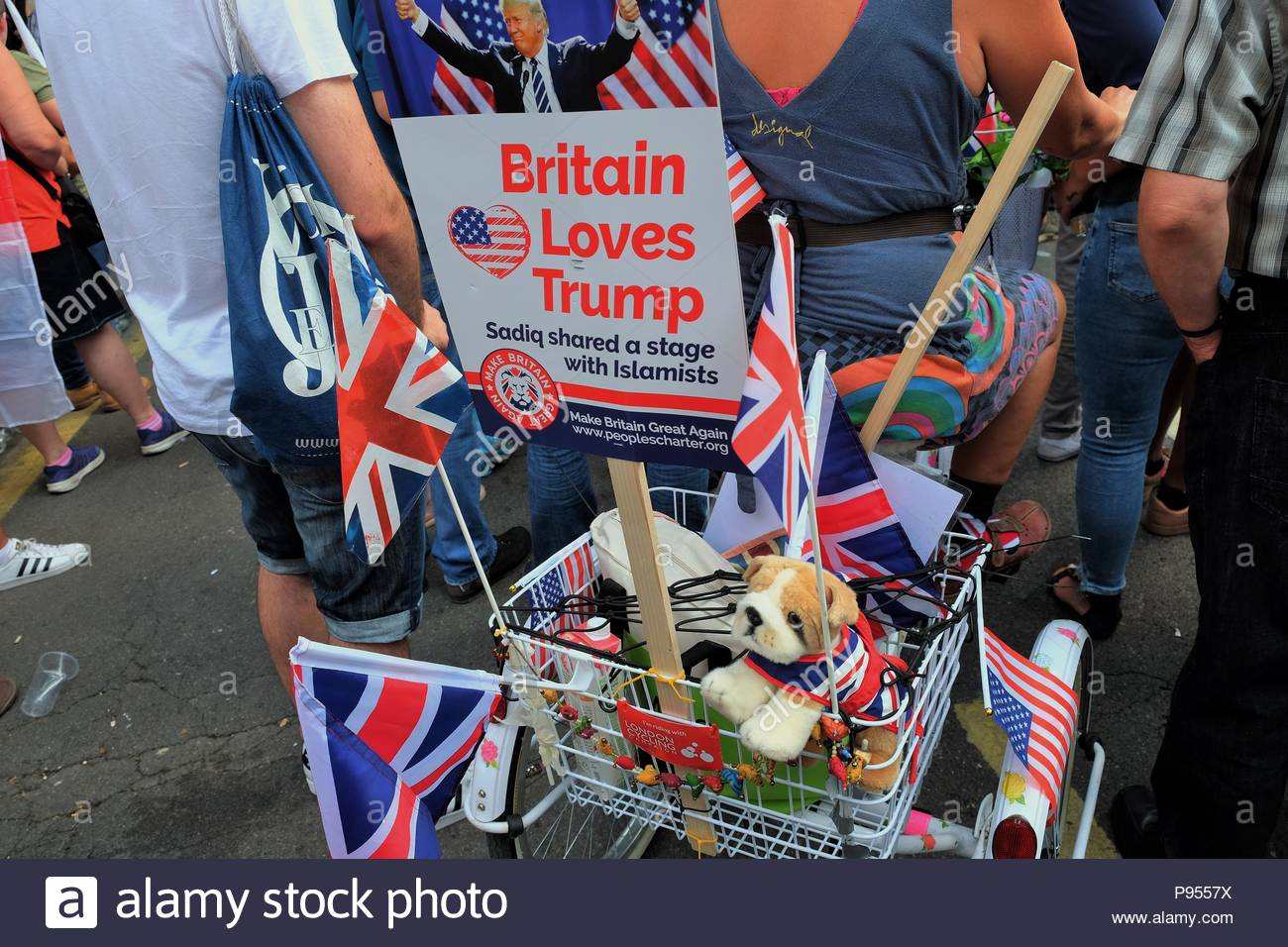 London, United Kingdom. 14th July, 2018. A sign reading 'Britain loves Trump' is held as hundreds of Trump supporters gather outside the US embassy in London, UK on July 14, 2018 for a Welcoming Trump to London rally in the British capital. Protesters called for the release of Tommy Robinson the founder of the English Defence League. (c) copyright Credit: CrowdSpark/Alamy Live News - Stock Image