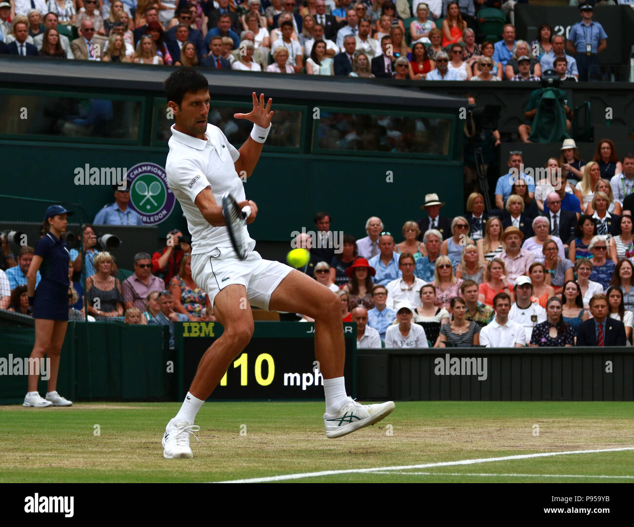 London, UK. 14th July 2018. Novak Djokovic in action in the conclusion of the Rafael Nadal and Novak Djokovic match.  Ladies Finals Day, Day 12 Wimbledon Tennis The Championships, Wimbledon, London, on July 14, 2018. Credit: Paul Marriott/Alamy Live News - Stock Image
