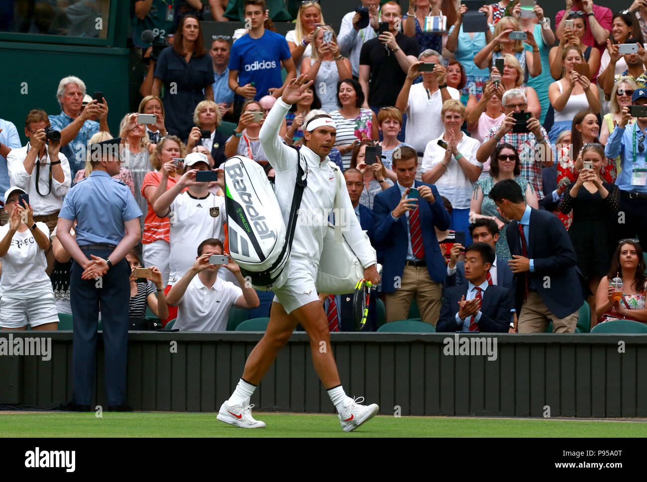 London, UK. 14th July 2018. Rafael Nadal returns to court to continue his epic battle with Novak Djokovic with finished at 11.00pm last night. Day, Day 12 Wimbledon Tennis The Championships, Wimbledon, London, on July 14, 2018. Credit: Paul Marriott/Alamy Live News - Stock Image
