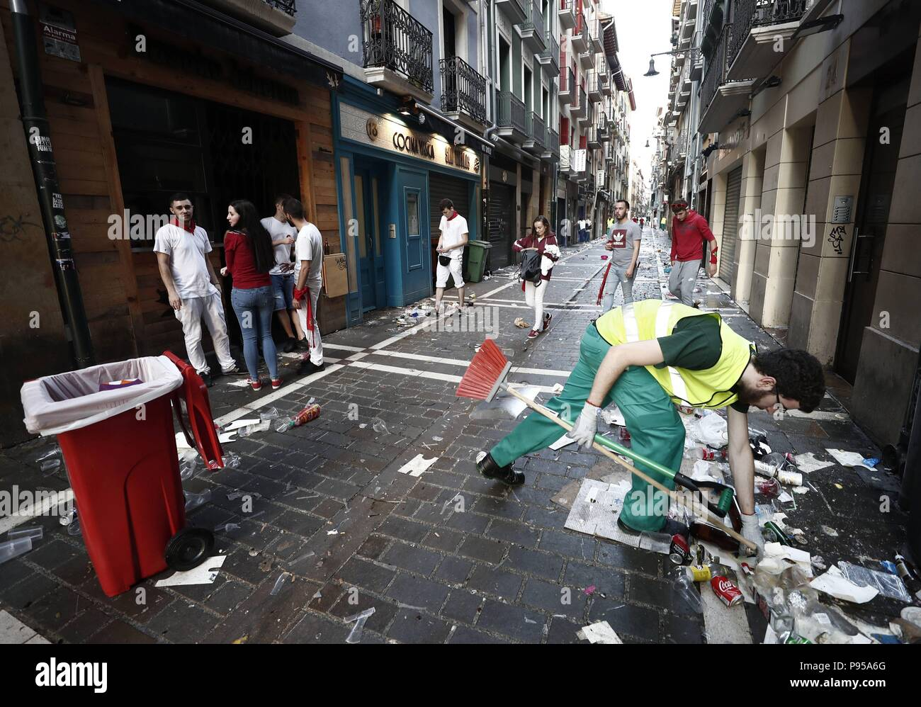 Pamplona, Spain. 15th July, 2018. A local worker cleans a street in the morning after the end of Sanfermines, in Pamplona, Spain, early 15 July 2018. At midnight thousands of people sang the traditional 'Pobre de mi', to express their regret for the end of the festivities. Credit: Jesus Diges/EFE/Alamy Live News Credit: EFE News Agency/Alamy Live News - Stock Image