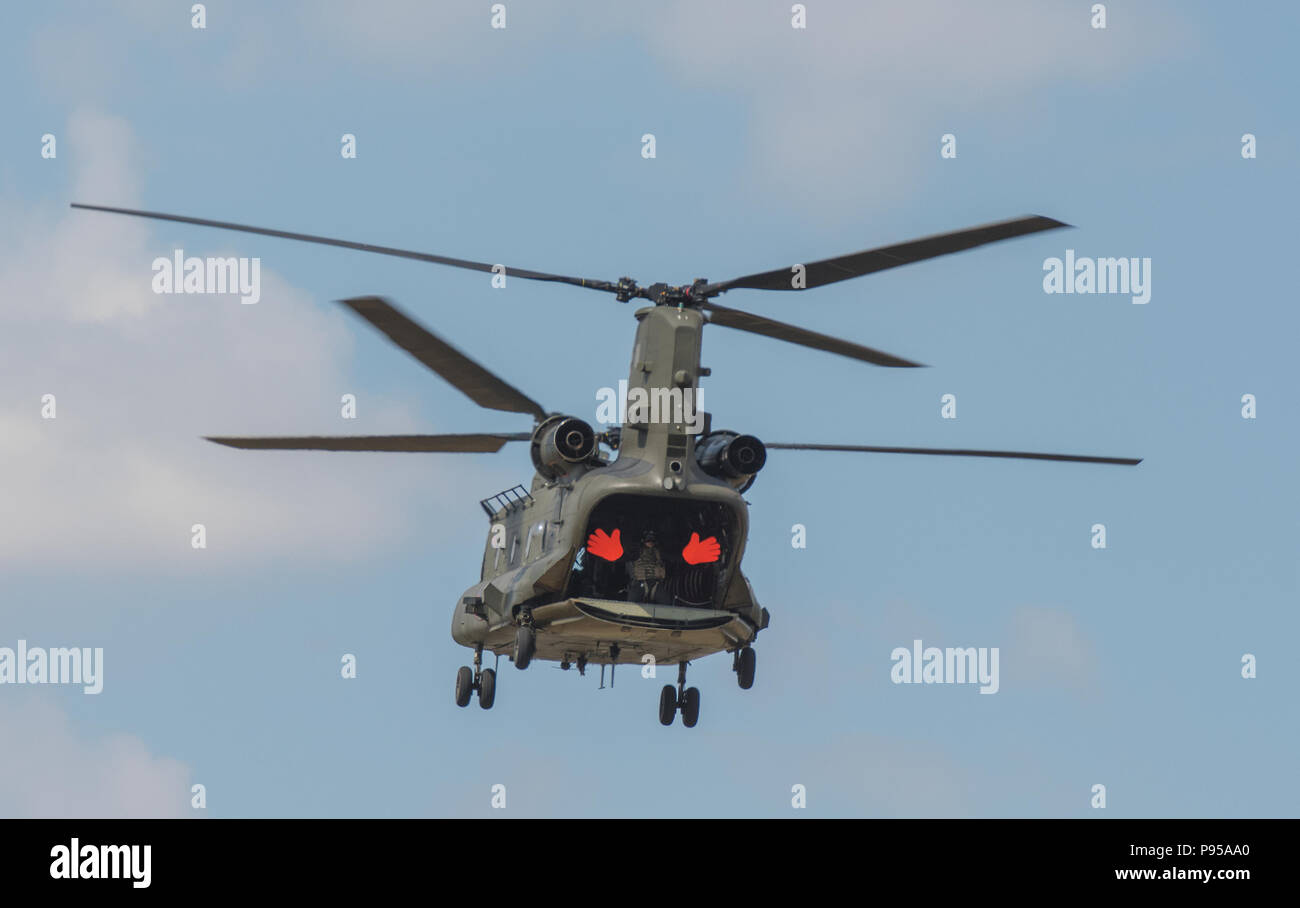 Gloucestershire, UK.14th July, 2018. The Royal International Air Tattoo, RAF Fairford, Gloucestershire, United Kingdom. Chinook helecopter at RIAT 2018 celebrating the 100th Anniversay Of the Royal Air Force with a massive air display at RAF Fairford in Gloucestershire. Air forces and fliers from arounf the world get together to provide stunning dislpays and areobatics for a huge record crowd of spectators. . Credit: Steve Hawkins Photography/Alamy Live News - Stock Image