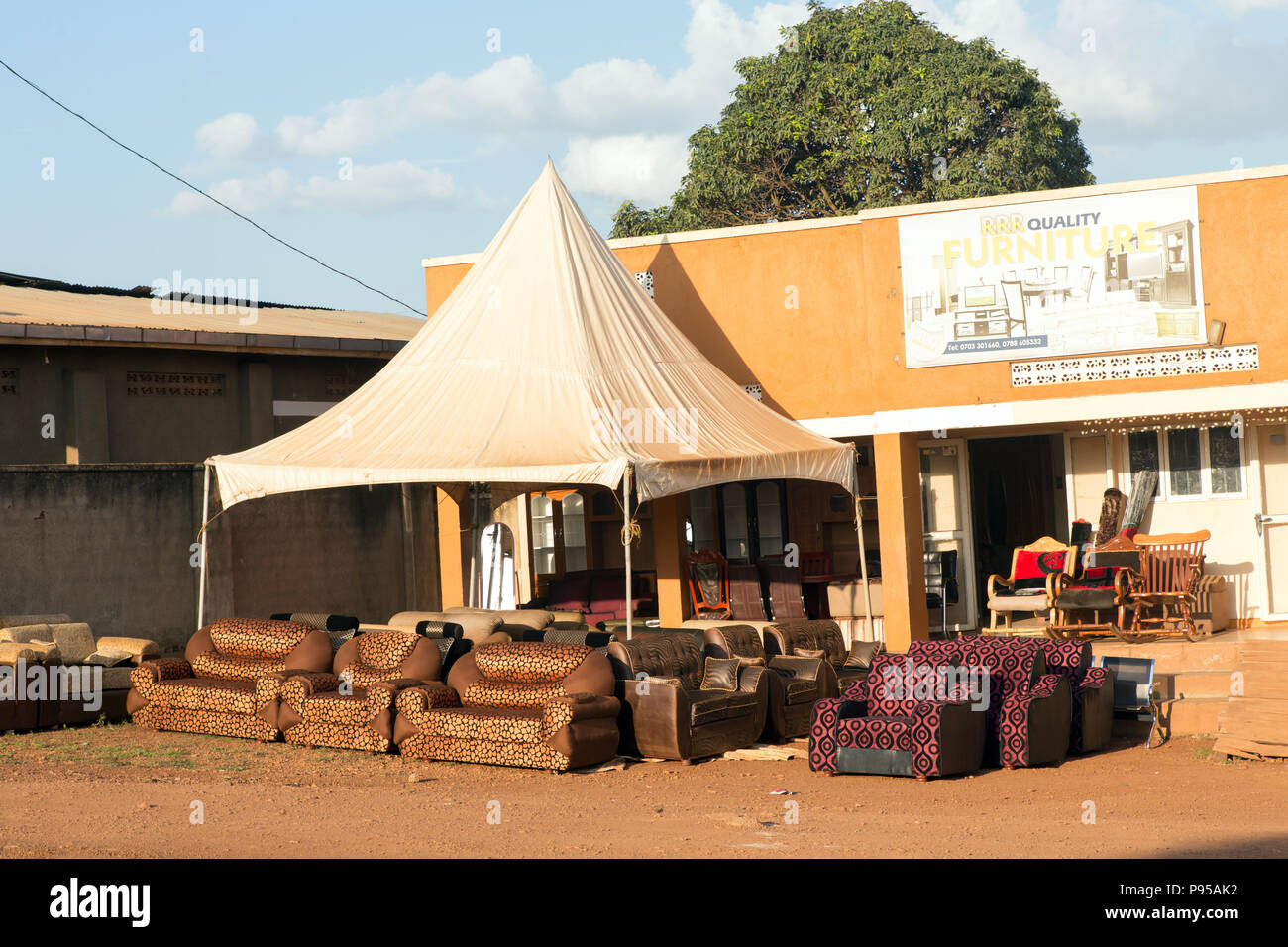 Wakiso Town, Uganda - Street scene. Sofas are in front of a furniture store. - Stock Image