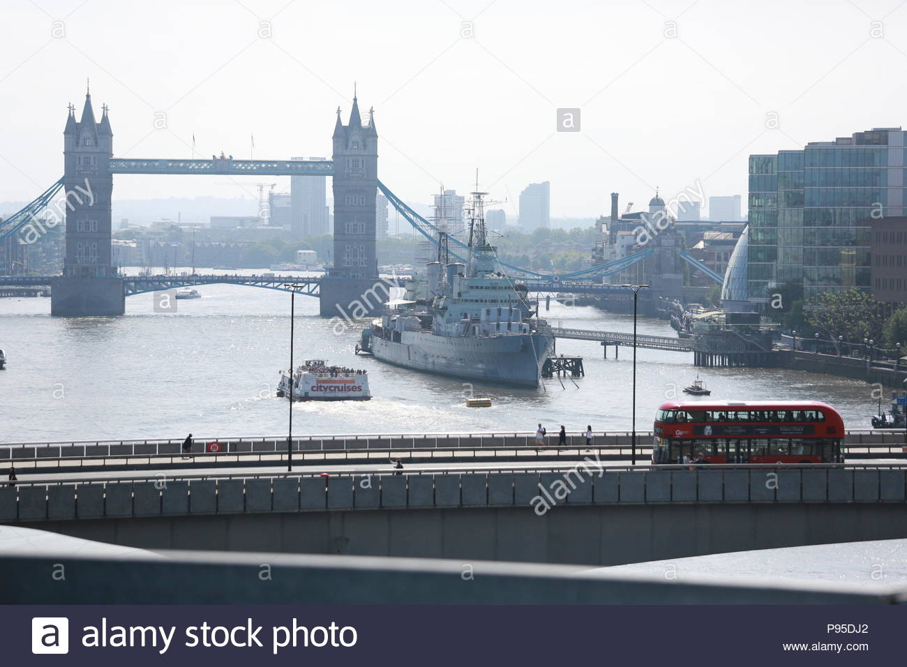Glorious weather in London as many buildings open for Open Gardens weekend giving beautiful views of the Thames, Tower Bridge and HMS Belfast. - Stock Image