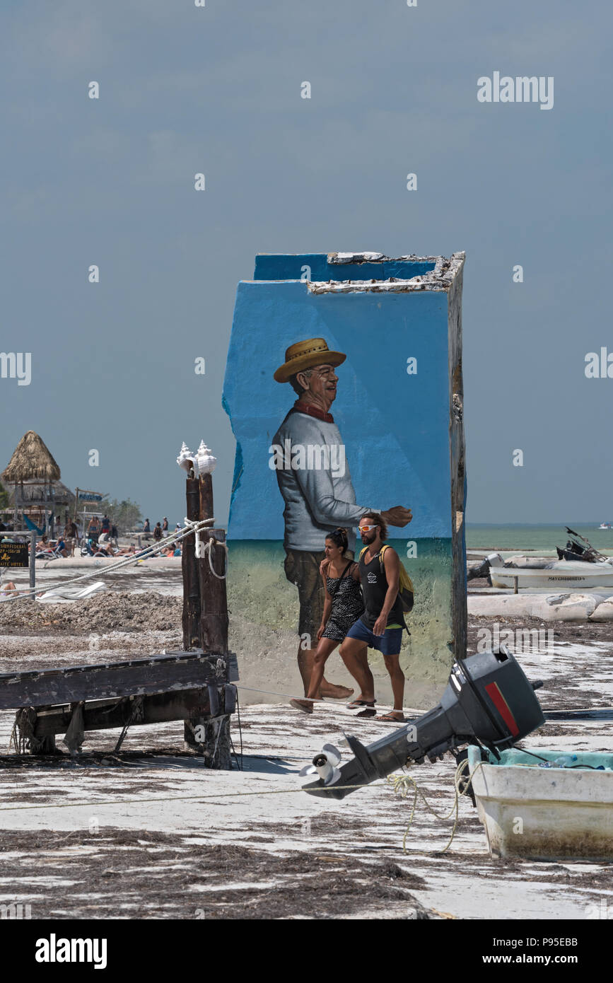 tourists in front of a ruin at tropical beach of Holbox island, Quintana Roo, Mexico. - Stock Image