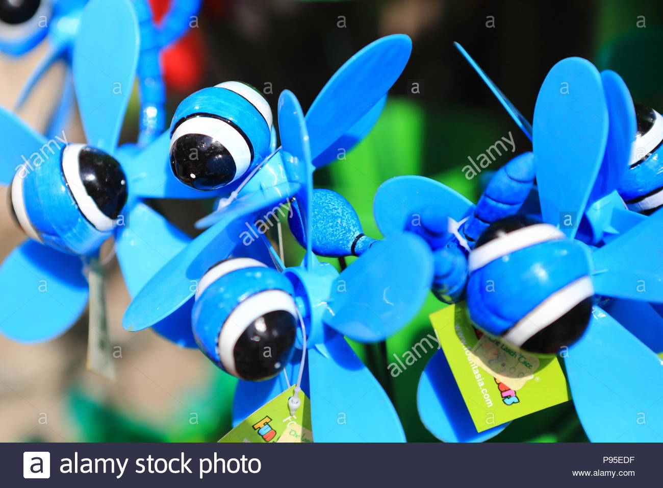 Novelty garden fun spinners at a store at Cartmel, Grange-Over-Sands, Cumbria, England. Summer July 2018 - Stock Image