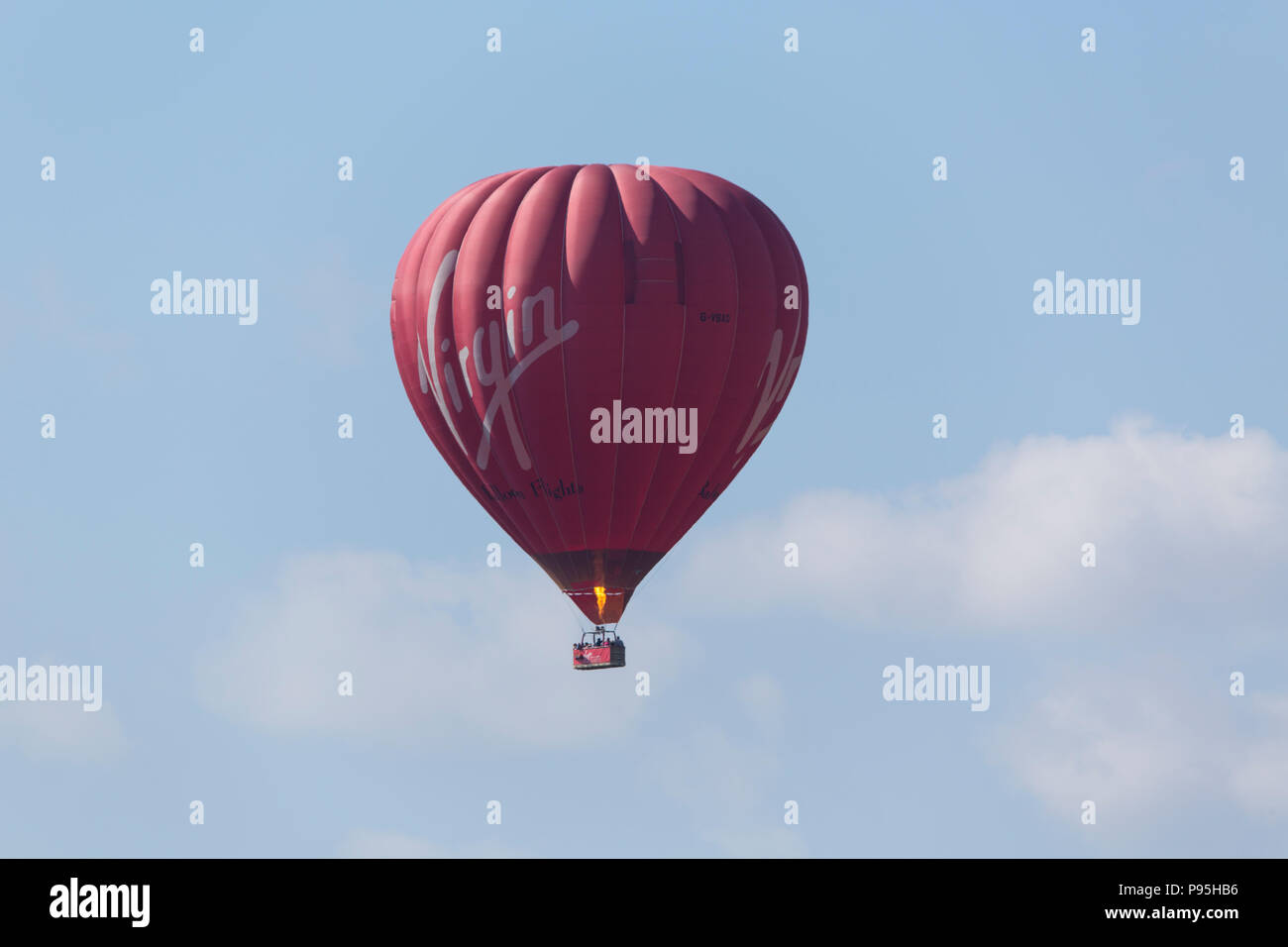 Hot air balloon in the sky over Rilla Mill in East Cornwall Stock Photo