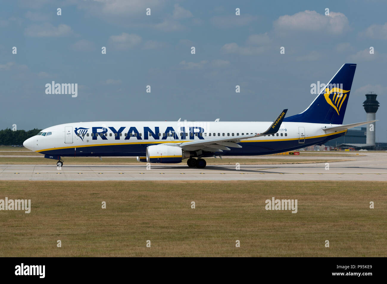 A Ryanair Boeing 737-8AS sits on the runway at Manchester Airport as it prepares to take-off. - Stock Image
