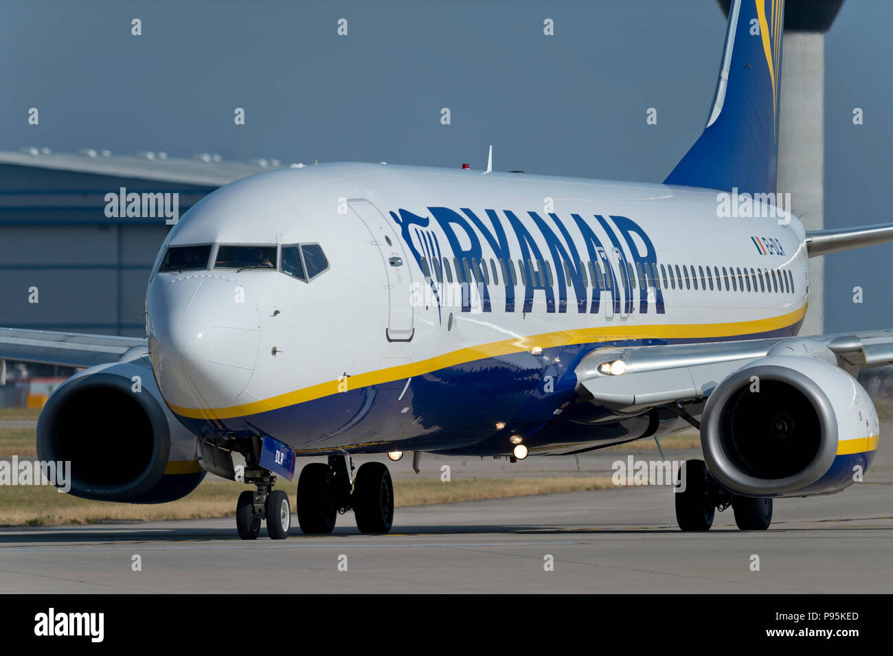 A Ryanair Boeing 737-8AS taxis along the runway at Manchester Airport whilst preparing to take off. - Stock Image