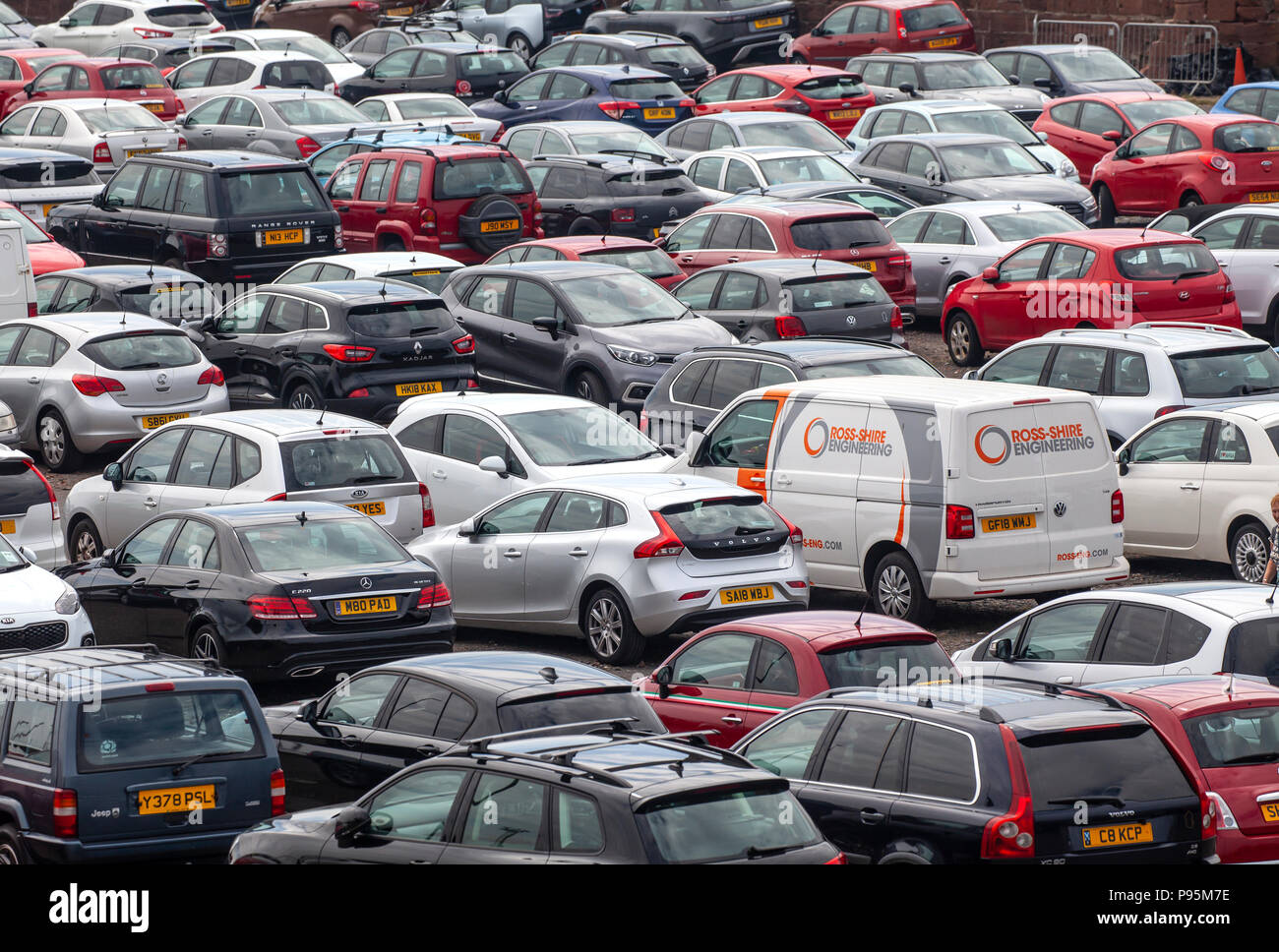 Elevated view of vehicles (Cars and a van) parked in a car park at Ardrossan Harbour, North Ayrshire, Scotland, UK - Stock Image