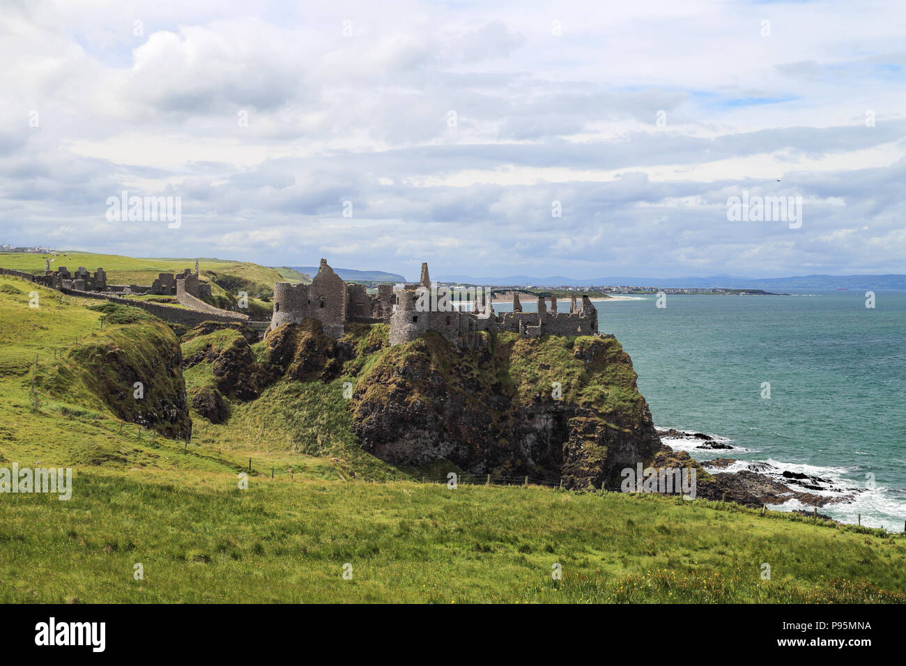 Dunluce Castle is a now-ruined medieval castle in Northern Ireland. It is located on the edge of a basalt outcropping in County Antrim. Stock Photo