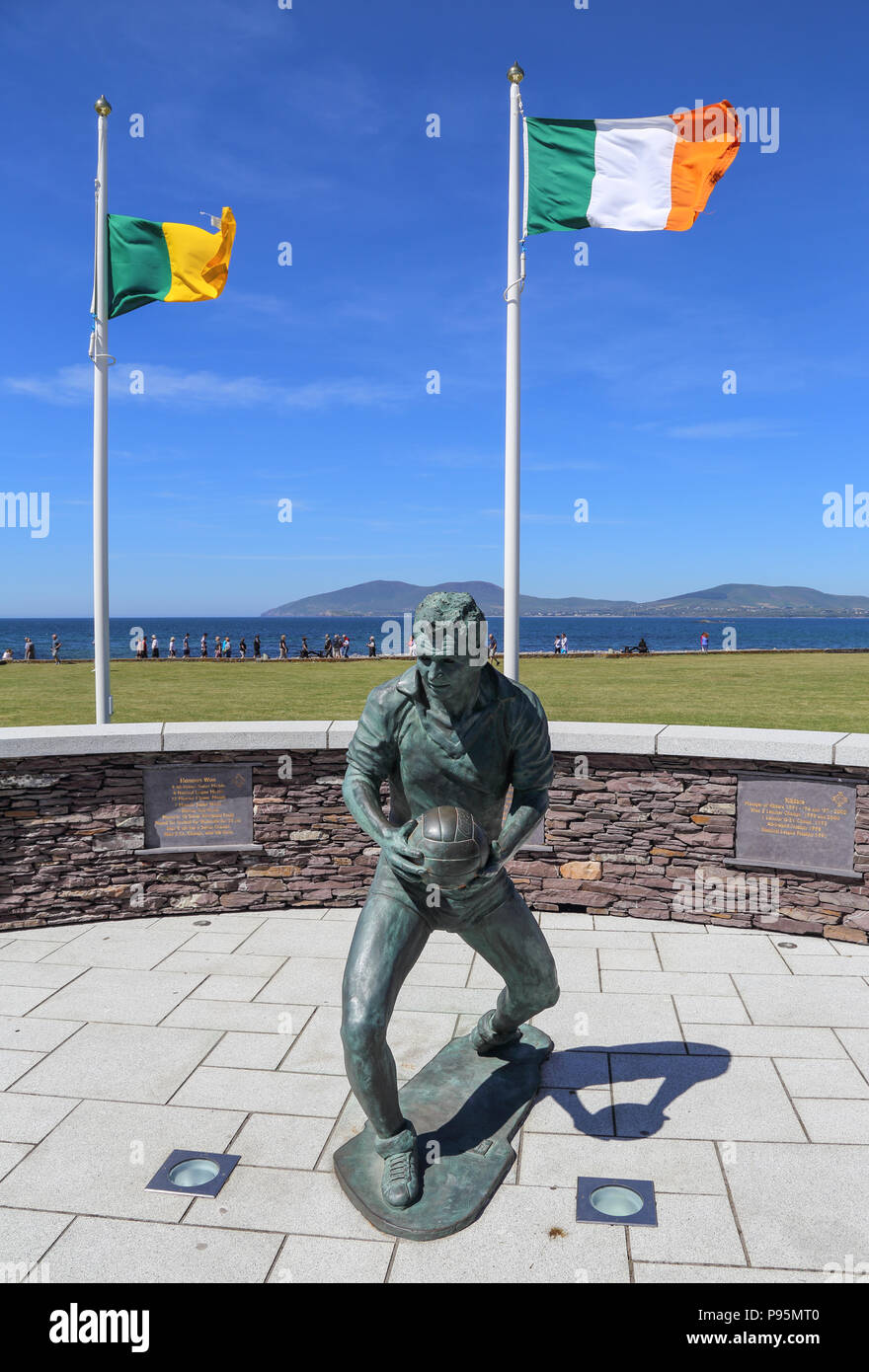 The bronze statue of famed Gaelic footballer and coach Mike O'Dwyer on the waterfront of waterville, Ireland, County Kerry - Stock Image